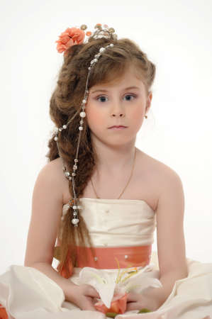 Girl in a smart dress and beautiful hair photo