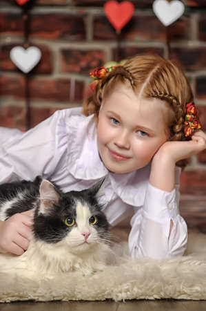 girl with a cat in her arms Stock Photo - 18999582