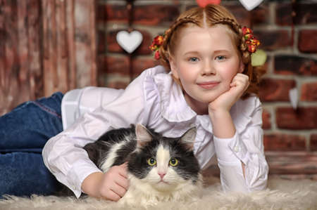 oversee: girl with a cat in her arms