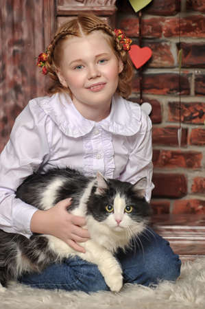 girl with a cat in her arms Stock Photo - 18999589