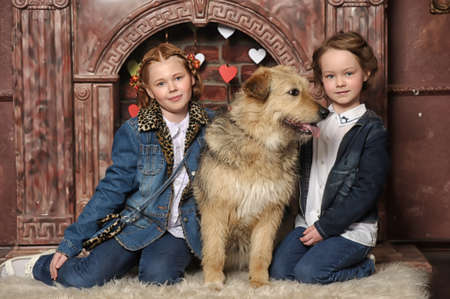 Two girls and a dog photo