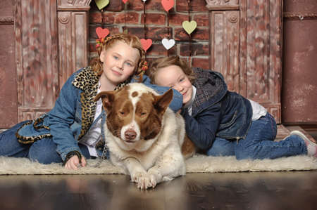 Two girls and a dog Stock Photo - 19238394