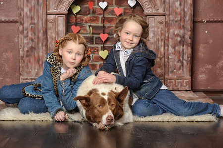 Two girls and a dog Stock Photo - 19238392