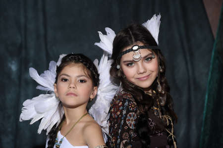 powow: Two girls in suits of American Indians