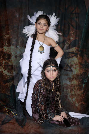 Two girls in suits of American Indians photo