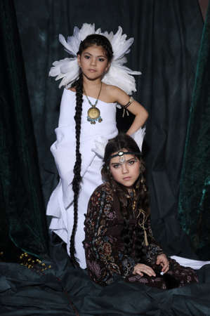 Two girls in suits of American Indians Stock Photo - 19902093
