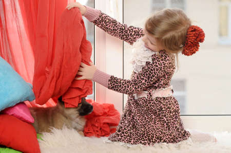 little girl with a puppy photo