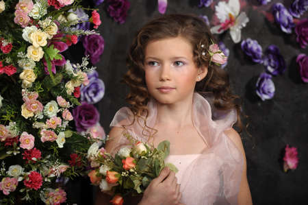 girl in a pink dress on a background of an arch of flowers Stock Photo - 19121547