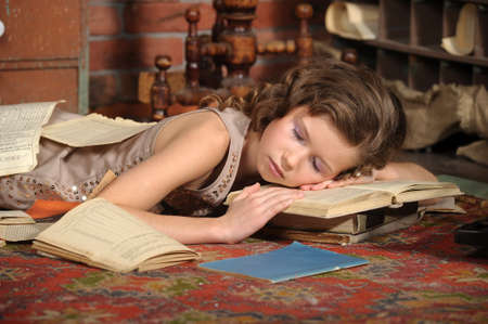 sleeping kid: girl fell asleep with books