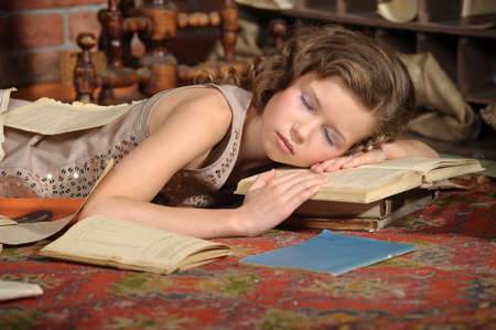 girl fell asleep with books photo