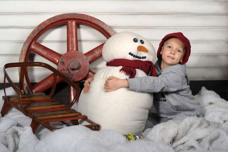 boy with a snowman photo