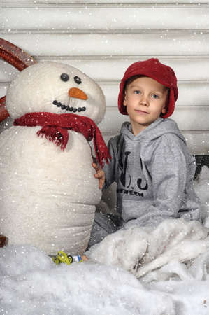 boy with a snowman photo