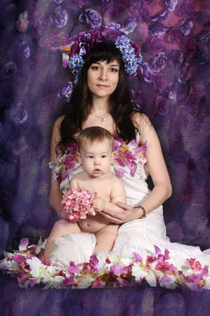 Mom in the flowers with a baby photo