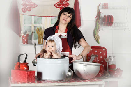 young mother and baby in the kitchen photo