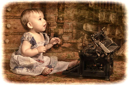 little girl with a typewriter photo