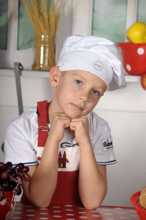 boy in a chef s hat photo
