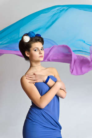 girl model posing in blue photo