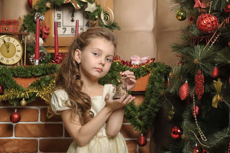 Vintage girl and Christmas tree photo