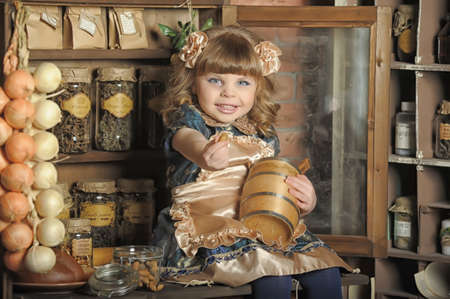 a little girl dressed in retro style on the old kitchen Stock Photo - 19204201