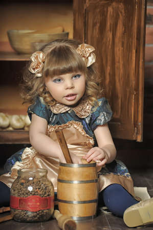kalabaka: a little girl dressed in retro style on the old kitchen
