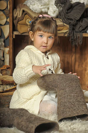 the little girl next to the wardrobe with warm clothes Stock Photo - 19224169