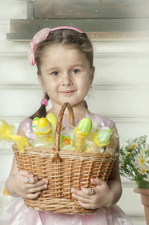 little girl with a basket with Easter eggs Stock Photo - 19204211