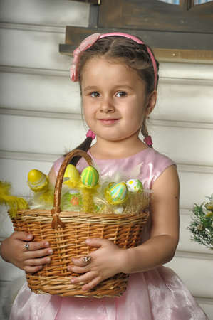 little girl with a basket with Easter eggs photo