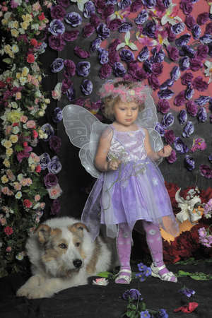 girl with butterfly wings and a dog Stock Photo - 19579861