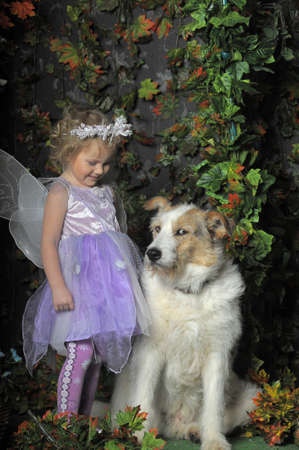 girl with butterfly wings and a dog photo
