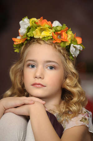 girl with a wreath of flowers on her head photo