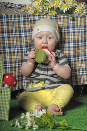 fussy: little girl with a toy fly agaric in hand