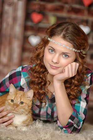Teen girl with a cat photo