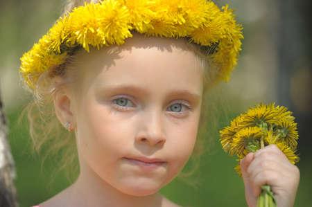 portrait of a girl with a wreath of dandelions photo