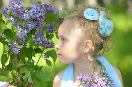 sandles: little girl with lilac