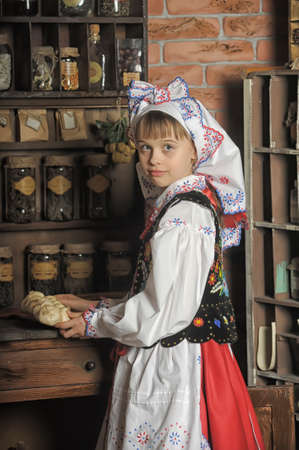 Girl in Polish national costume photo
