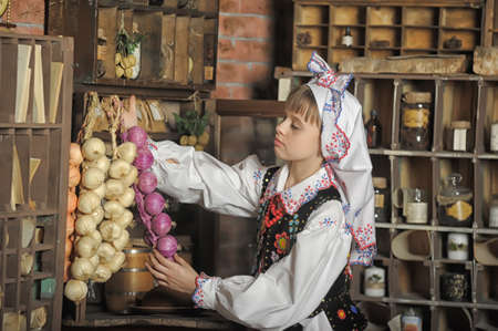 Girl in Polish national costume of Russia photo