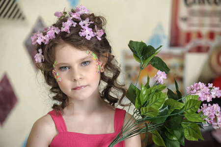 portrait of a girl with flowers in her hair, and in the hands of Stock Photo - 19397337