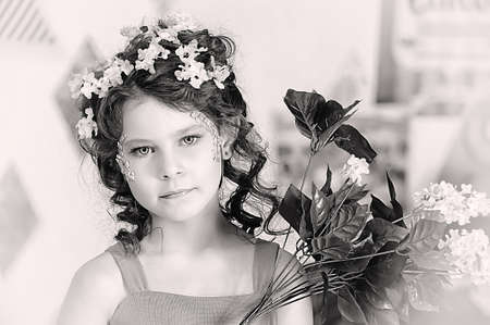 portrait of a girl with flowers in her hair, and in the hands of photo