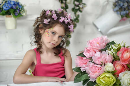 portrait of a girl with flowers in her hair, and in the hands of Stock Photo - 19397322