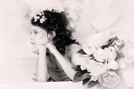 portrait of a girl with flowers in her hair, and in the hands of Stock Photo - 19397309