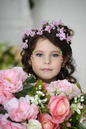 portrait of a girl with flowers in her hair, and in the hands of Stock Photo - 19338945