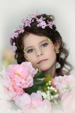 portrait of a girl with flowers in her hair  Stock Photo - 19338942