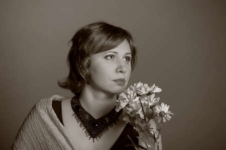 sad woman with yellow flowers photo