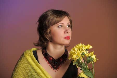 sad woman with yellow flowers photo