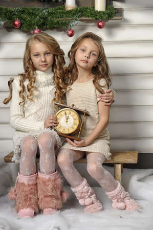 children s: Two girls are ready to greet the new year