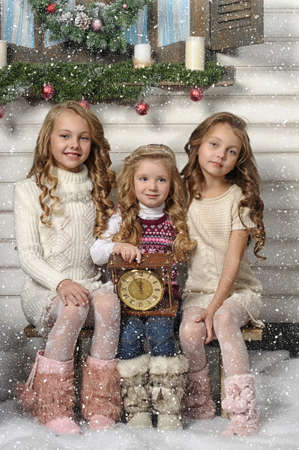 Three girls are ready for the celebration of the new year Stock Photo - 19577374