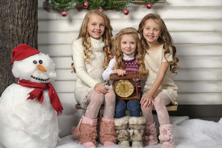 child s: Three girls are ready for the celebration of the new year