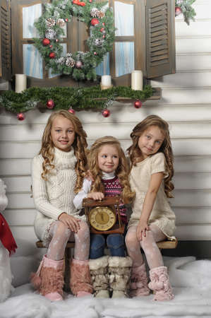 Three girls are ready for the celebration of the new year photo