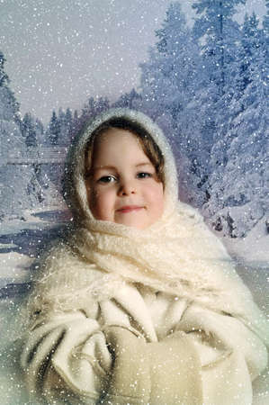 little girl with a scarf in winter photo