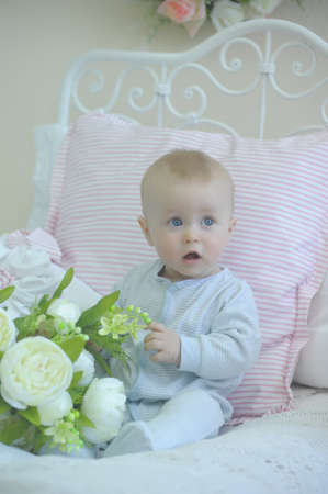 cute baby and white peonies Stock Photo - 19338024